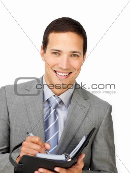 Smiling businessman holding an agenda