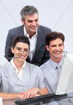 Charismatic businessteam working at a computer