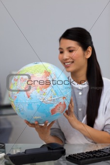 Beautiful Asian businesswoman with the world