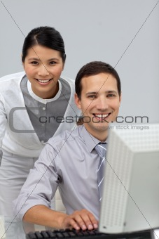Assertive Asian businesswoman helping her colleague