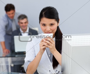 Assertive Businesswoman drinking a coffee at her desk