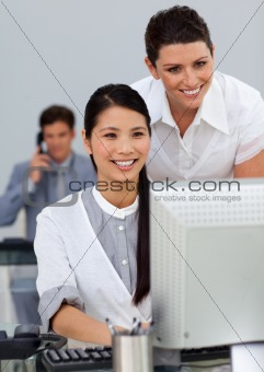 Attractive manager checking her employee's work