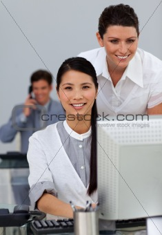 Charismatic young manager checking her employee's work