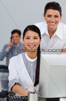 Smiling business women helping her colleague