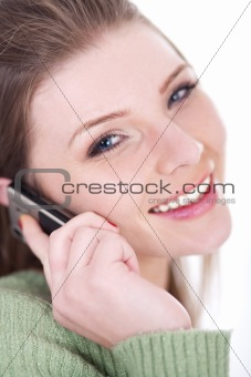 Smiling beautiful girl speaking over cell phone