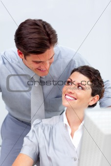 Positive business team working at a computer