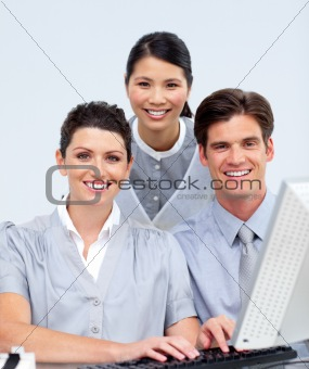 Charming business group working at a computer