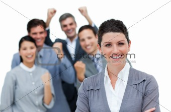 Cheerful business partners punching the air in celebration