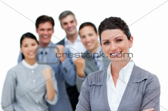 Positive business partners punching the air in celebration