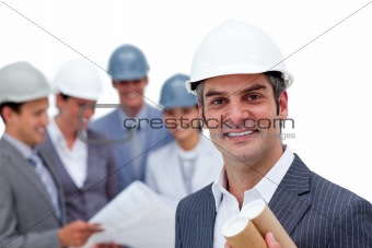 Charismatic male architect on phone in front of his team