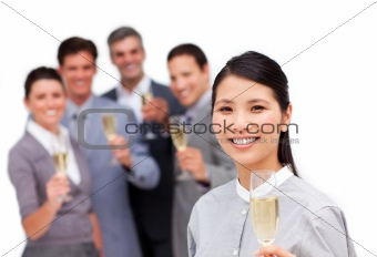 Brunette manager and her team celebrating a success