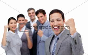 Successful business team punching the air in celebration