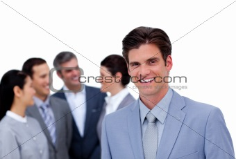 Charismatic businessman standing in front of his team