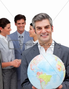 Ambitious manager and his team holding a terrestrial globe