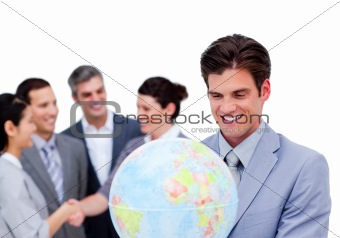 Charismatic manager and his team holding a terrestrial globe