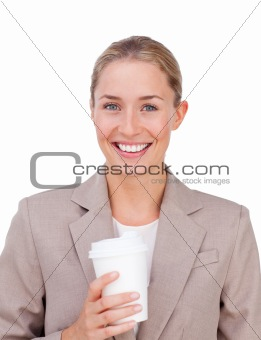 Positive businesswoman drinking a coffee