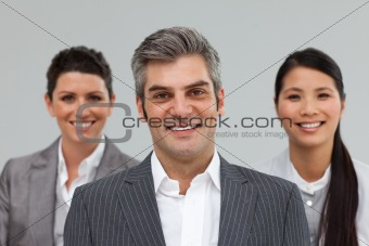Smiling Business partners standing together