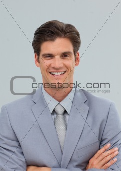 Charismatic businessman with folded arms