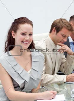 Charming businesswoman making notes