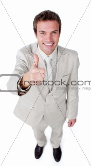 Positive businessman with thumb up