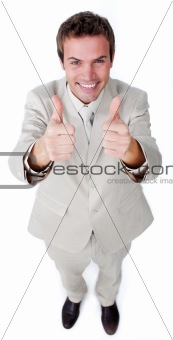 Victorious businessman with thumbs up