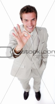 Assertive businessman showing OK sign