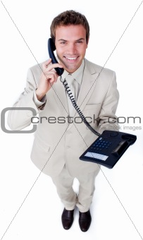 Smiling businessman talking on phone