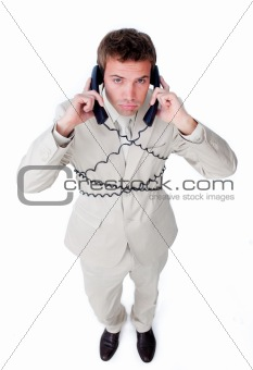 Tired businessman tangle up in phone wires