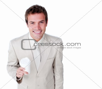 Smiling businessman holding a drinking cup