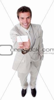 Assertive caucasian businessman holding a white card