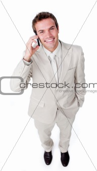 Positive businessman using a mobile phone