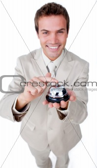 Smiling businessman using a service bell