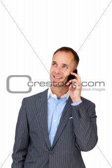 Charming businessman on phone looking upward