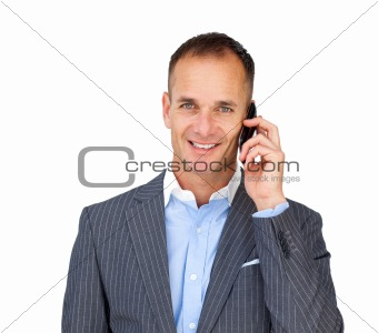 Assertive businessman using a mobile phone