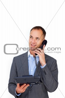 Positive businessman talking on a phone