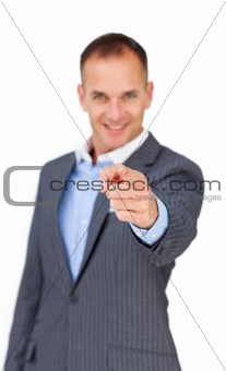 Charismatic businessman pointing at the camera