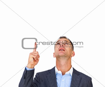 Surprised businessman pointing upward