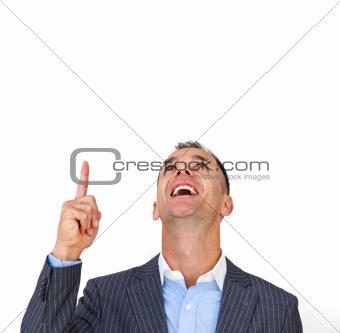 Smiling businessman pointing upwards