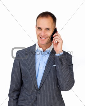 Charismatic attractive businessman using a mobile phone