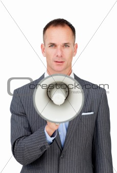 Serious businessman holding a megaphone 