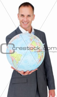 Cheerful businessman holding a terreatrial globe