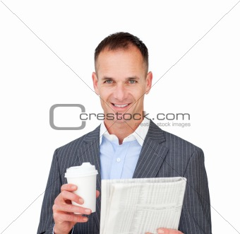 Assertive businessman reading a newspaper