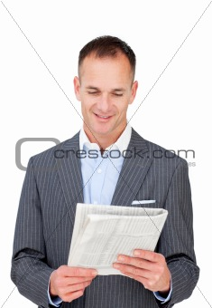 Positive businessman reading a newspaper