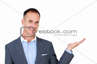 Smiling businessman showing a copyspace
