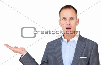 Surprised businessman showing a copyspace