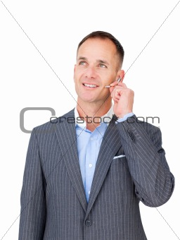 Charismatic businessman using headset