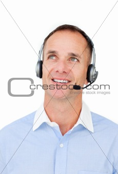 Attractive businessman using headset