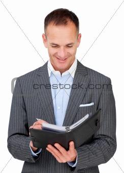 Arttractive businessman consulting his agenda