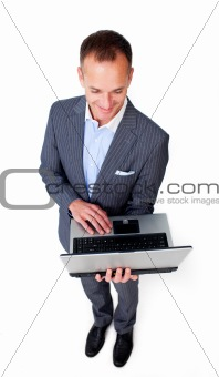Concentrated businessman using a laptop
