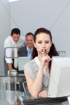Charming businesswoman asking for silence